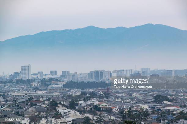 tanzawa mountains and residential districts in kanagawa prefecture of japan - chigasaki stock pictures, royalty-free photos & images