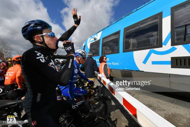 Tao Geoghegan Hart of United Kingdom and Team Sky Tim Declercq of Belgium and Team Deceuninck QuickStep and peloton stopped waiting for the train to...
