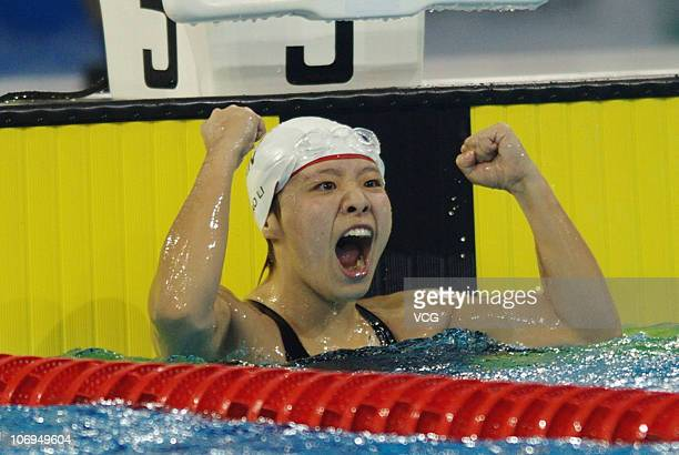 Tao Li of Singapore celebrates after winning the gold medal in the Women's 50m Butterfly final during day six of the 16th Asian Games Guangzhou 2010...