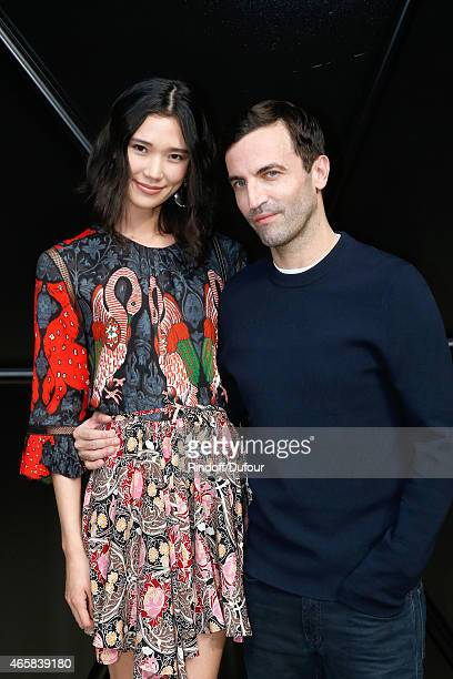 Tao Okamoto and Fashion Designer Nicolas Ghesquiere pose after the Louis Vuitton show as part of the Paris Fashion Week Womenswear Fall/Winter...