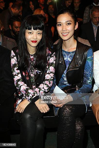 Tao Okamoto and Rila Fukushima attend the Givenchy show as part of the Paris Fashion Week Womenswear Spring/Summer 2014 on September 29 2013 in Paris...