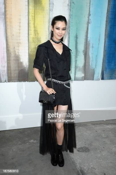 Tao Okamoto attends the Chanel show as part of the Paris Fashion Week Womenswear Spring/Summer 2014 at Grand Palais on October 1 2013 in Paris France