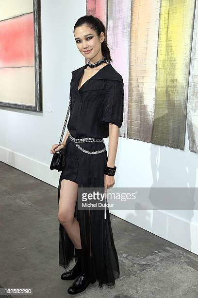 Tao Okamoto attends the Chanel show as part of the Paris Fashion Week Womenswear Spring/Summer 2014 on October 1 2013 in Paris France