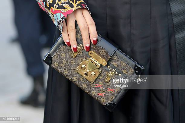 Tao Okamoto handbag detail arrives at the Louis Vuitton show as part of the Paris Fashion Week Womenswear Spring/Summer 2016 on October 7 2015 in...