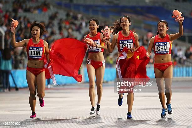 Tao Yujia Kong Lingwei Lin Huijun and Wei Yongli of China celebrate claiming the Gold medal in the Women's 4x100m Relay Final during day thirteen of...