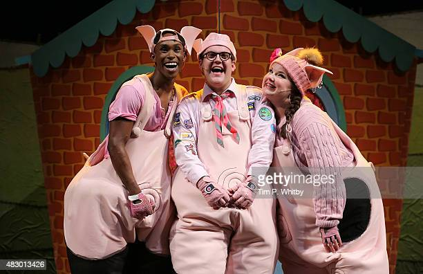 Taofique Folarin Daniel Buckley and Leanne Jones perform on stage during a photocall for The Three Little Pigs at Palace Theatre on August 5 2015 in...