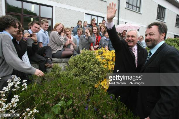Taoiseach Bertie Ahern and Candidate Dennis O'Donavan wave to students of Bandon Grammer School during his canvassing tour of Co Cork