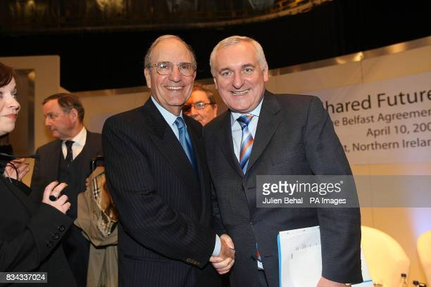 Taoiseach Bertie Ahern shaking hands with Senator George Mitchell in Belfast where politicians who negotiated The Good Friday Agreement ten years ago...