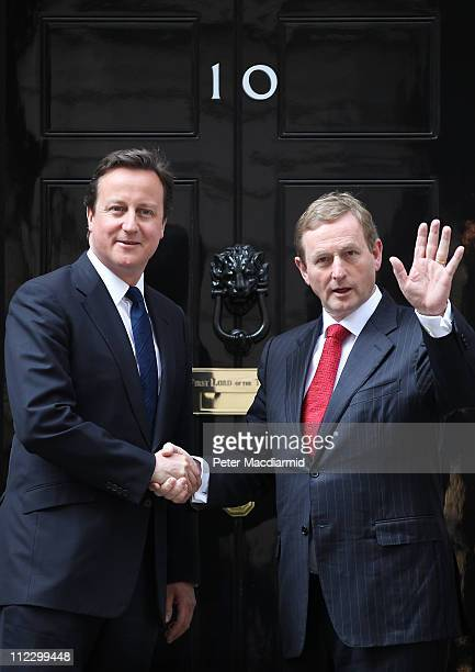 Taoiseach Enda Kenny waves as he meets with Prime Minister David Cameron at 10 Downing Street on April 18 2011 in London England This is the first...