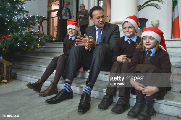 Taoiseach Irish Prime Minister Leo Varadkar poses for a photo with children at the end of the department's staff choir performance during an annual...