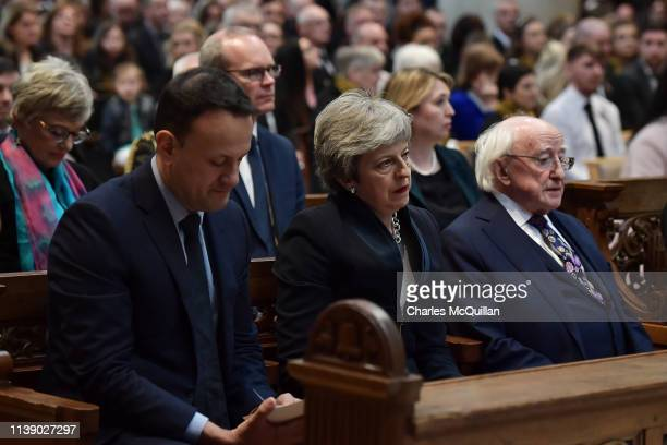 Taoiseach Leo Varadkar British Prime Minister Theresa May and President of Ireland Michael D Higgins sit together while Secretary of State for...
