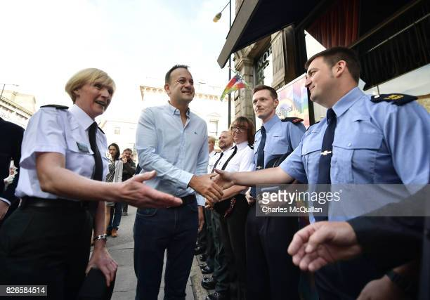 Taoiseach Leo Varadkar is greeted by PSNI and Garda police officers representative of the gay community as he attends a Belfast Gay Pride breakfast...