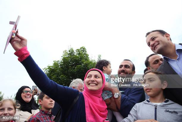 Taoiseach Leo Varadkar poses for a picture with Huda Safa'a AlDeen her husband Zaid Mohammed and their daughter Zainab Mohammed during a visit to an...