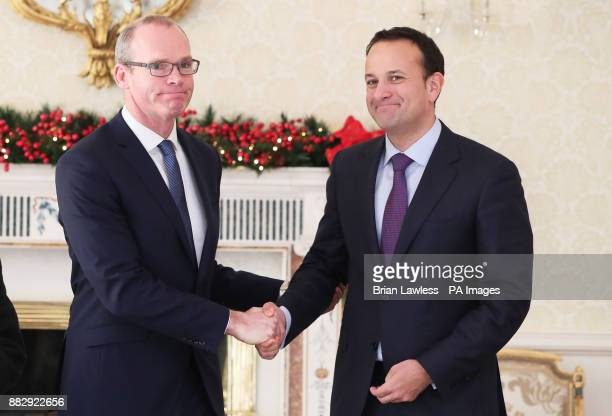 Taoiseach Leo Varadkar shakes hands with the newly appointed Tanaiste Simon Coveney at the Aras in Dublin following the resignation of Frances...
