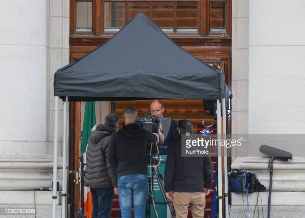 Taoiseach Micheal Martin announces new restrictions at the entrance to Government Building in Dublin. From Christmas Eve restaurants and pubs have to...