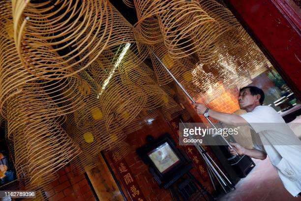 Taoist Ong pagoda Incense coils hang from the ceiling Can Tho Vietnam