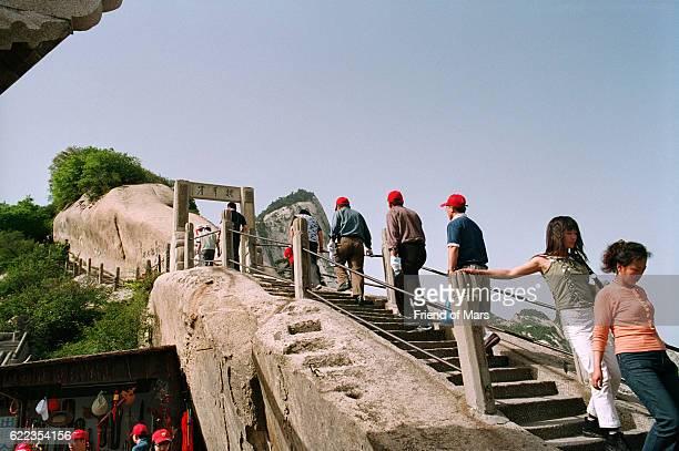 Taoist pilgrims trekking up sacred Mount Hua