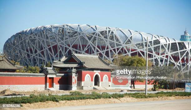 Taoist temple in front of Beijing National Stadium, also known as the Bird's Nest, Beijing, China.