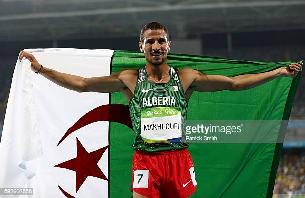 Taoufik Makhloufi of Algeria celebrates after winning silver in the Men's 1500 meter Final on Day 15 of the Rio 2016 Olympic Games at the Olympic...