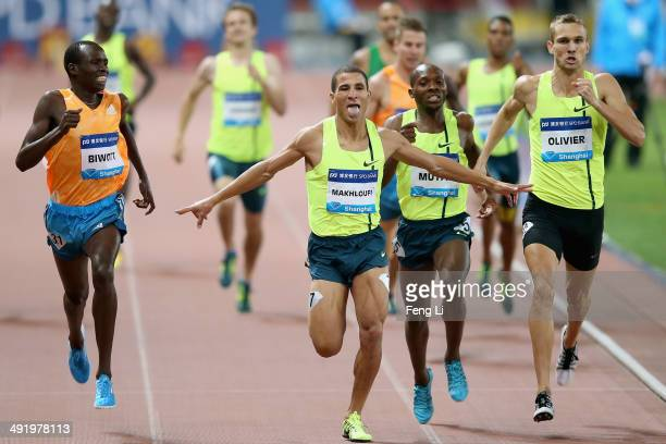Taoufik Makhloufi of Algeria crosses the finishing line during the Men's 800m of the Diamond League Track and Field competition at Shanghai Stadium...