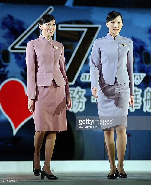 Taiwan's leading air carrier China Airlines unveils new uniforms for its crew in a hangar of the island's northern Taoyuan airport 4 November 2006...