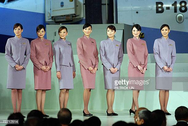 Taiwan's leading air carrier China Airlines unveils new uniforms for its crew in a hangar of the island's northern Taoyuan airport 04 November 2006...