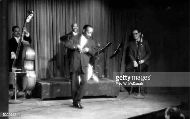 Tap dancer Groundhog performs with a backing trio led by drummer Jo Jones onstage at the Village Gate nightclub New York New York November 17 1964