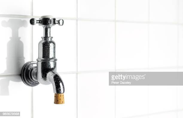 tap with cork, water conservation - water conservation stock pictures, royalty-free photos & images