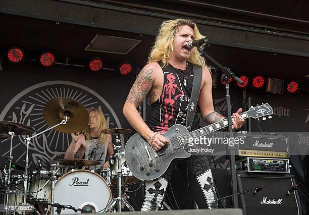 Tapani 'Taz' Fagerström and Arttu 'Archie' Kuosmanen Finnish of the rock band Santa Cruz performs at MAPFRE Stadium on May 17 2015 in Columbus Ohio