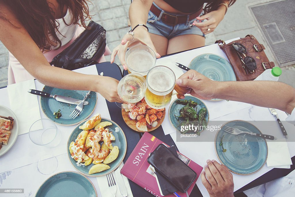 Tapas and beer toast : Stock Photo