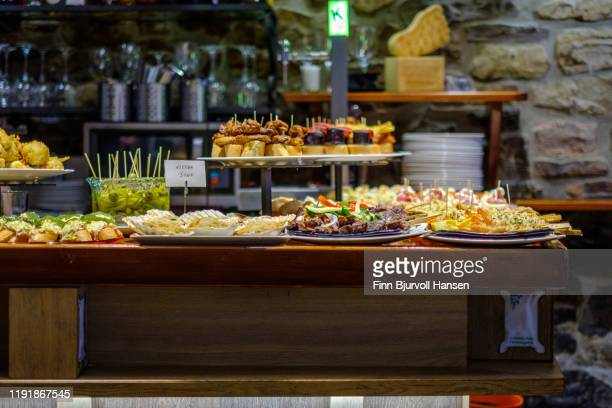 tapas and pinxos in a bar in san sebastian spain - finn bjurvoll ストックフォトと画像