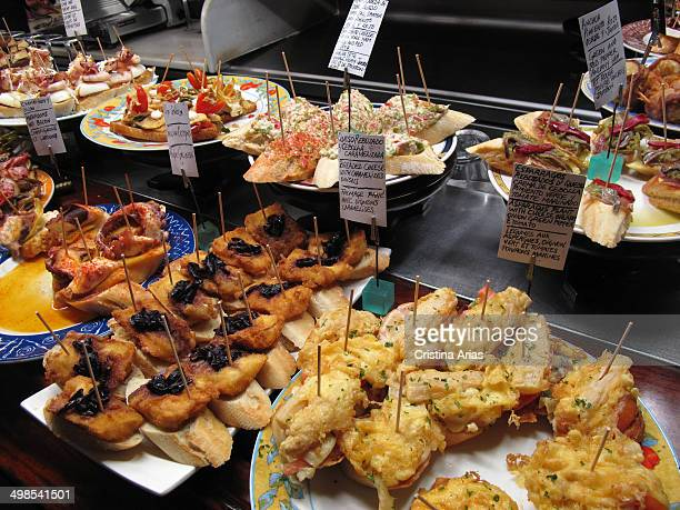 Tapas at the counter of a bar in San Sebastian traditional and more elaborate tapas and pinchos are a small sample of the renowned Basque cuisine San...