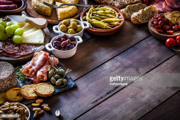 tapas frame on rustic wooden table - antipasto stock pictures, royalty-free photos & images