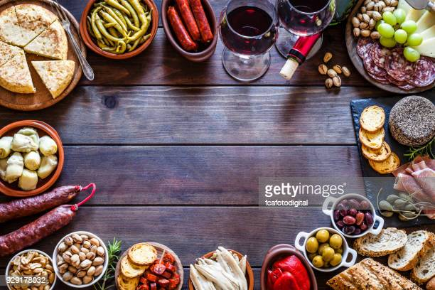 tapas frame on rustic wooden table - appetizer stock pictures, royalty-free photos & images