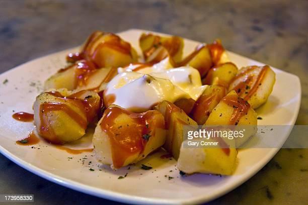 Tapas of spicy potatos