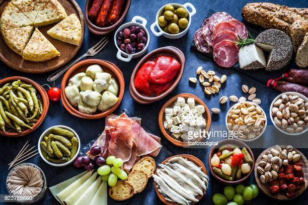 tapas on bluish tint table shot from above - tapas stock photos and pictures