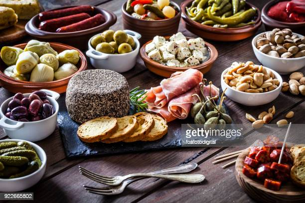 tapas on rustic wooden table - antipasto stock pictures, royalty-free photos & images