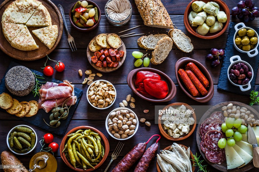 Tapas on rustic wooden table shot from above : Stock Photo