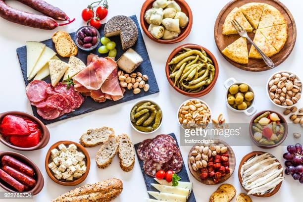 tapas on white background - delicatessen stock pictures, royalty-free photos & images