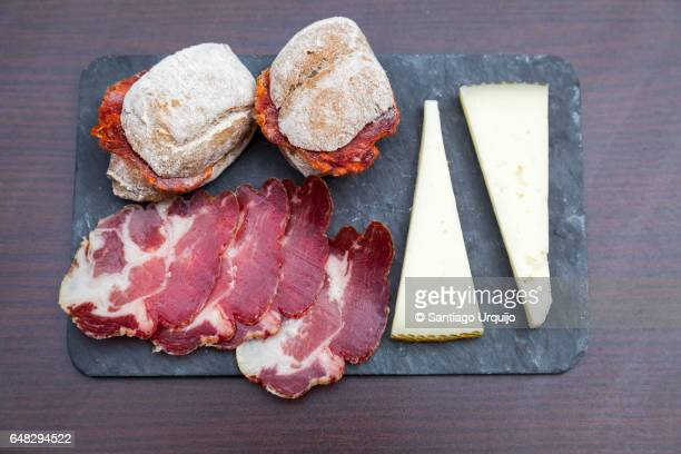 tapas served on a slate - tapas stock photos and pictures