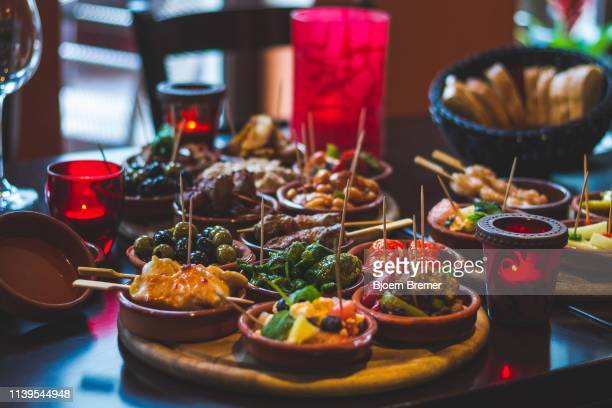 tapas snacks in a tapas bar - tapas stock photos and pictures