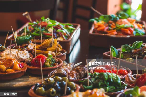 tapas snacks in a tapas bar - spanish culture stock pictures, royalty-free photos & images
