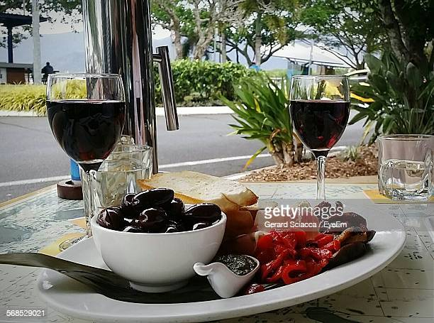 Tapas With Wine Served On Table