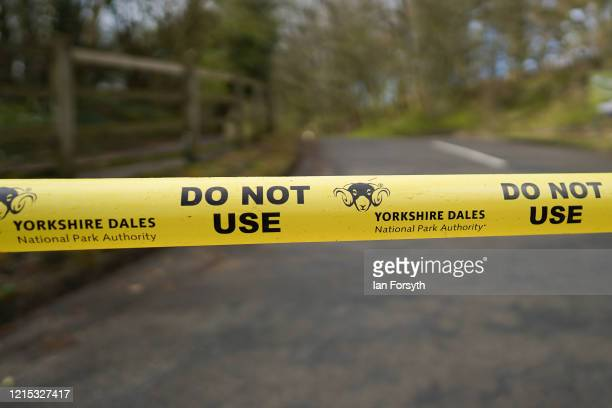 Tape closes off the entrance to the Asygarth Falls visitor centre as Police Officers from North Yorkshire Police and Park Rangers from the Dales...