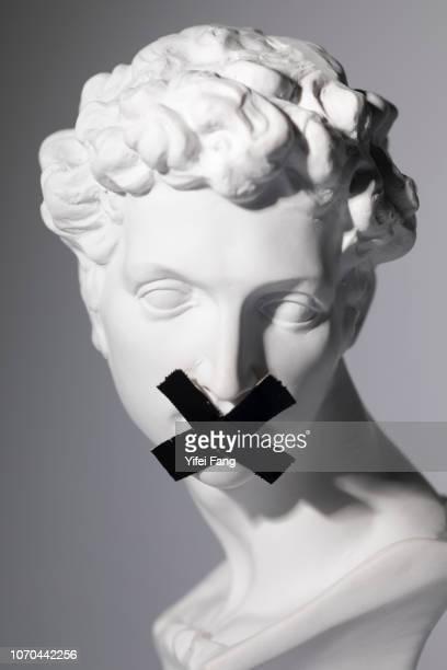tape covering mouth - coprire foto e immagini stock