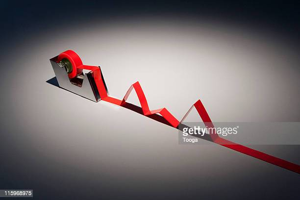 tape dispenser with red tape growth chart - bureaucracy stock pictures, royalty-free photos & images