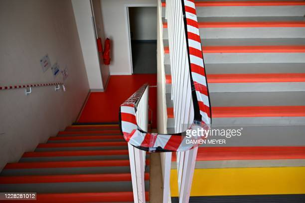Tape is put along the length of the stair banister to stop students from touching to curb the spread of the novel coronavirus, Covid-19, ahead of a...