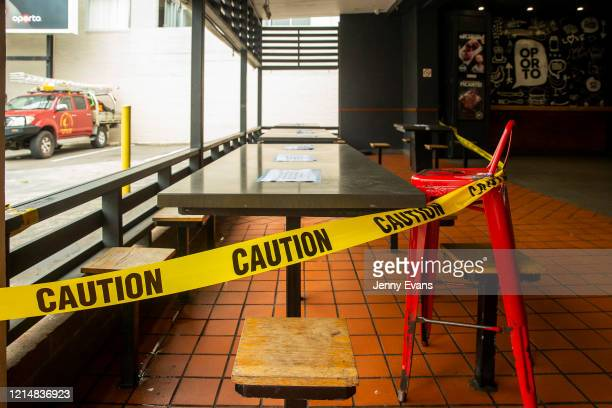 Tape is seen cordoning off the dining section of a chicken shop now serving takeaway food on March 26 2020 in Sydney Australia Further restrictions...