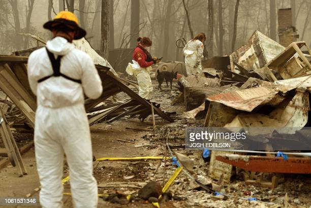 Tape marks an area where a body was found as rescue workers continue searching for human remains at a burned residence in Paradise California on...