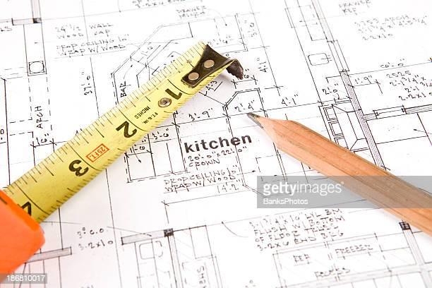 Tape Measure and Carpenter's Pencil on Home Plans (Kitchen)